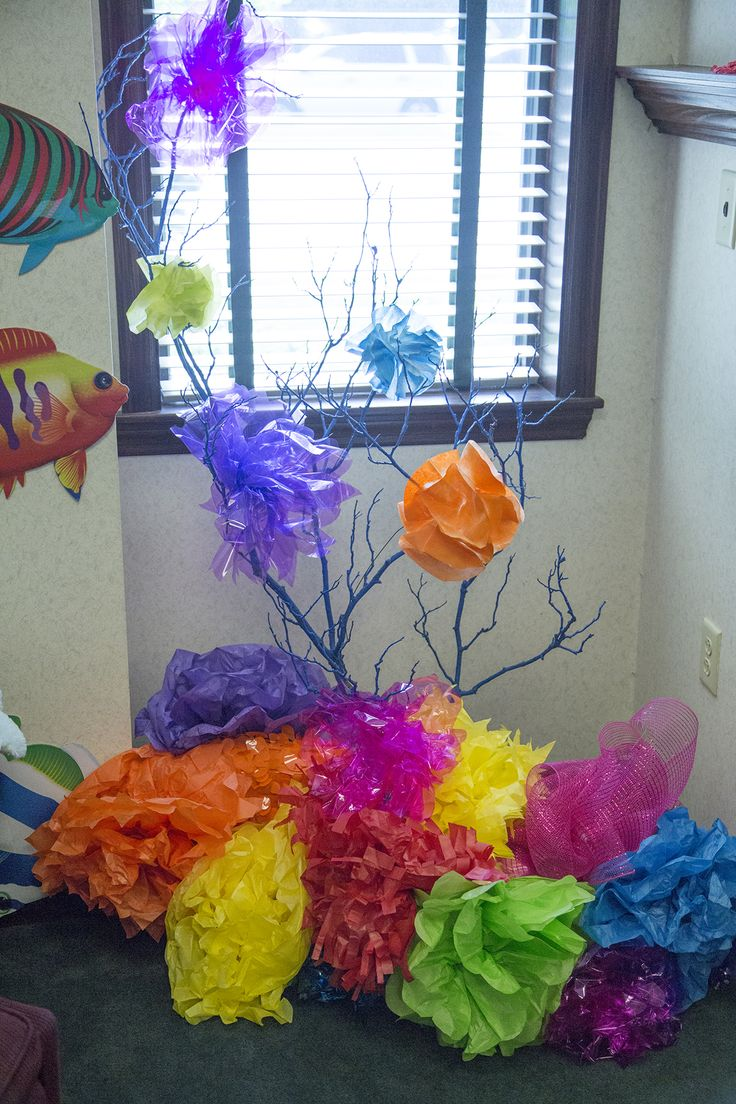 Easy decorations for an underwater VBS -- coral made from painted tree branches and tissue paper #oceancommotion #vbs2016