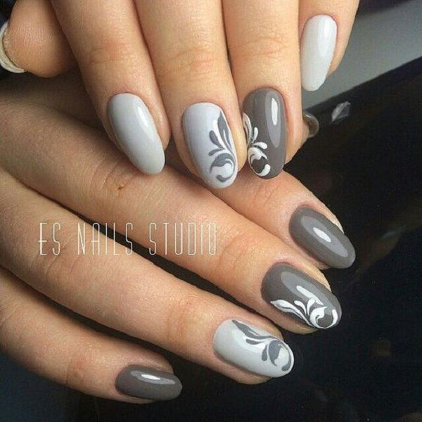 Simple yet very elegant looking winter nail art. The white gray and dark gray combination makes the nails look very warm yet pleasant to the eyes. The simple curve design adds to the elegance of the nail art.