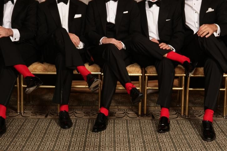Showing some flair with bright red socks.  Grooms should have fun, too!