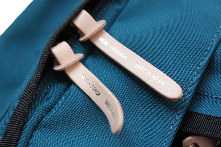 Textile, fabric, blue, bag, stitched, leather, zipper, puller, detail, branding, washable paper