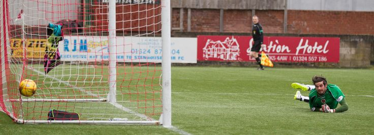 The ball hits the net to take the score to 2-0 to Queen's Park during the Ladbrokes League One game between Stenhousemuir and Queen's Park.