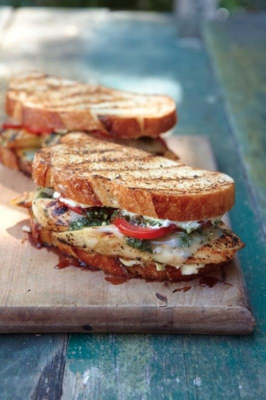 Pesto Chicken Sandwiches: 4 boneless, skinless chicken breast halves, about 6 oz. each, Kosher salt and freshly ground pepper, 1 tsp. Italian seasoning, Olive oil for brushing, 8 slices fontina cheese, 8 slices sourdough bread, Mayonnaise (optional), 8 thick tomato slices, 4 Tbs. pesto, homemade or store-bought
