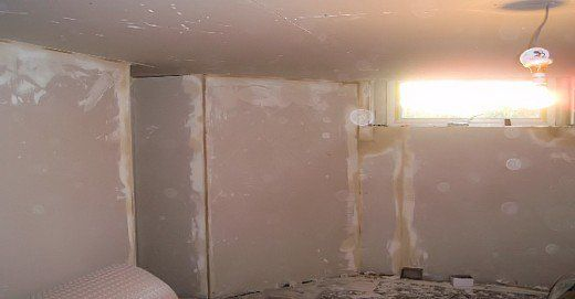 Help on how to plasterboard using the Dot and Dab method on block and brick walls. Advice on plaster boarding walls.