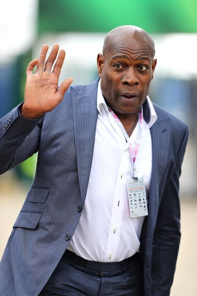 Frank Bruno Photos - Former boxer Frank Bruno walks in the Paddock before the Formula One Grand Prix of Great Britain at Silverstone on July 10, 2016 in Northampton, England. - F1 Grand Prix of Great Britain