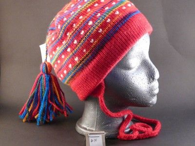 Knitted hat with thrums and earflaps. Adult size. 100% wool.