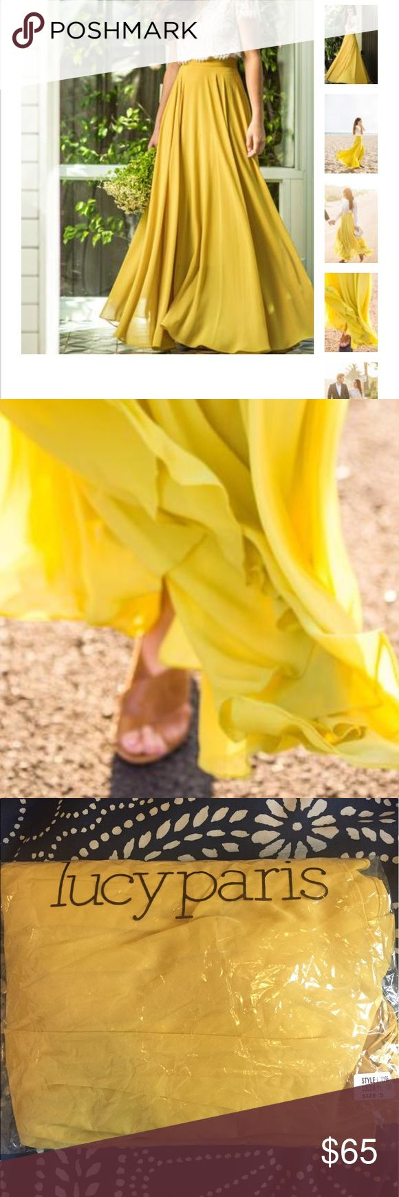 "Lucy Paris yellow maxi skirt Absolutely stunning yellow maxi skirt. High waisted, flowy, and romantic. Waist 28"" Length 44"" Skirts Maxi"