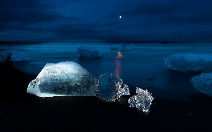 """""""Some of the icebergs at the Jökulsárlón glacier lagoon are large and imposing,"""" said Ragnar. """"Floating icebergs melt and roll over with a lot of noise, splashing and making waves.The stranded icebergs that exist in the Breiðamerkurfjara beach area of the national park tend to melt, crumble and disperse into rolling ice chunks in the water.""""  Picture: Ragnar Th.Sigurðsson / Barcroft Media: Iceland 12, Serene Scene, Beach, Icelandic Obsession, Beautiful Photography, Beautiful Pictures, Beautiful Land, Nice Pictures"""