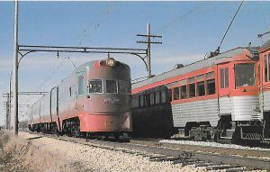 """On its 50th Anniversary in 1991, an Electroliner passes a Silverliner (built 1917) at the Illinois Railway Museum. """"Each day holds a surprise. But only if we expect it can we see, hear, or feel it when it comes to us. Let's not be afraid to receive each day's surprise,..."""