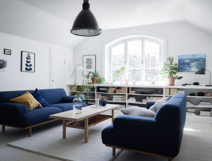 Scandinavian interior styling and ideas how to decorate the blue sofa.