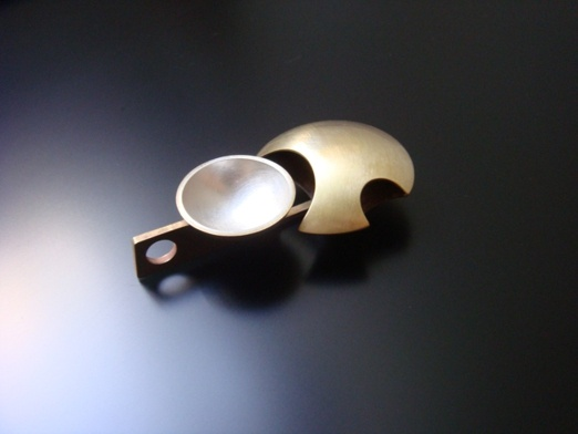 Silver and brass brooch