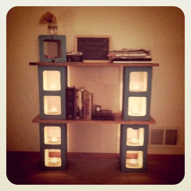 cinder block shelf against wall.. out door living room? I love the candles!
