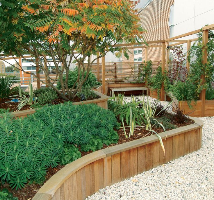 Decoration, Inspiring Garden With Wooden Retaining Wall Also Traditional Outdoor Bench Put On White Pebble Ground ~ Fabulous Retaining Wall Design Ideas