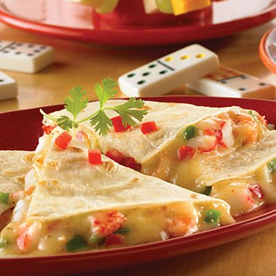 Seafood Quesadillas - I use scallops or the lump crab meat chopped. Rather than peppers, I use either chives or chopped green onion & sometimes with a bit of chili powder over top. I'll put 3 on a baking sheet because it's faster. Then slice with a pizza cutter.