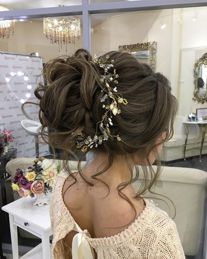 aacf2c6bfa5 Messy Bridal hair updo with hair accessories