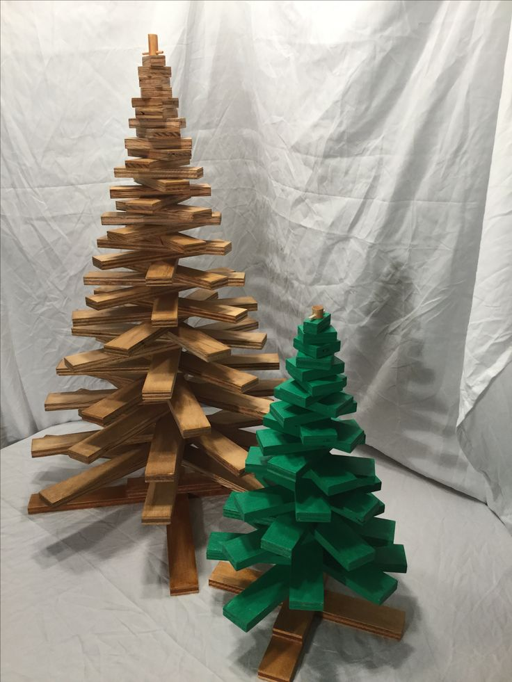 """Wooden Christmas tree plans to make 2 different size wooden spiral/spoke shaped Christmas trees. Larger tree stands 27""""inches tall x 18"""" inches wide. Smaller tree stands 16"""" inches tall x 10""""inches wide. You can rotate the branches to make trees have different shapes ."""