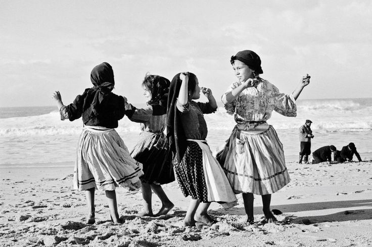 A group of girls dance on the beach in Nazaré in Portugal in 1956. Perlmutter...