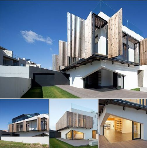 House uses Operable Wood Louvers for Temperature Control.