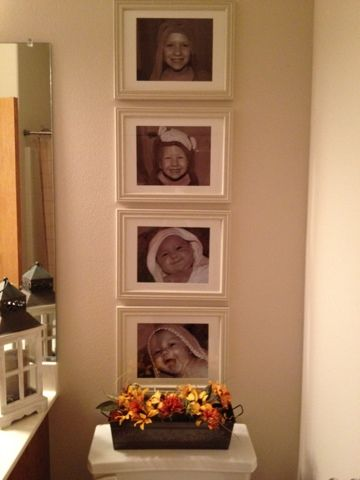 Bathroom Wall Decoration - Pictures of kids in their hooded towels displayed in bathroom.