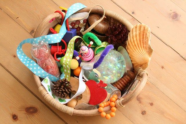 Baby treasure basket - 12 months. Nontoxic, safe, varied objects that can be changed out for new objects on occasion.