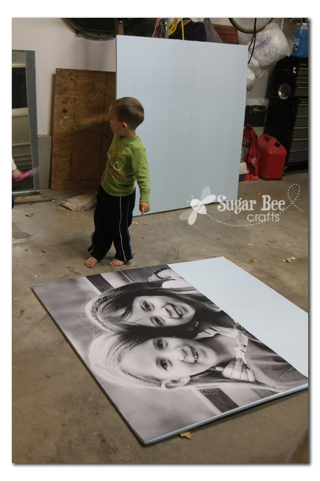 "Staples will do ""engineer prints"" of a photo for $8. Glue on foam board and you're ready to go"