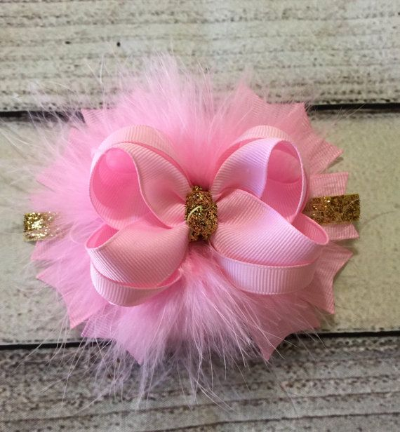 Pink and gold stacked hair bows Bow measures approx 4.5 This bow is made of high quality grosgrain ribbon All hair bows are heat sealed to prevent fraying. **NOTE** This item contains small parts. Please do not leave young children unattended while wearing this The color may be