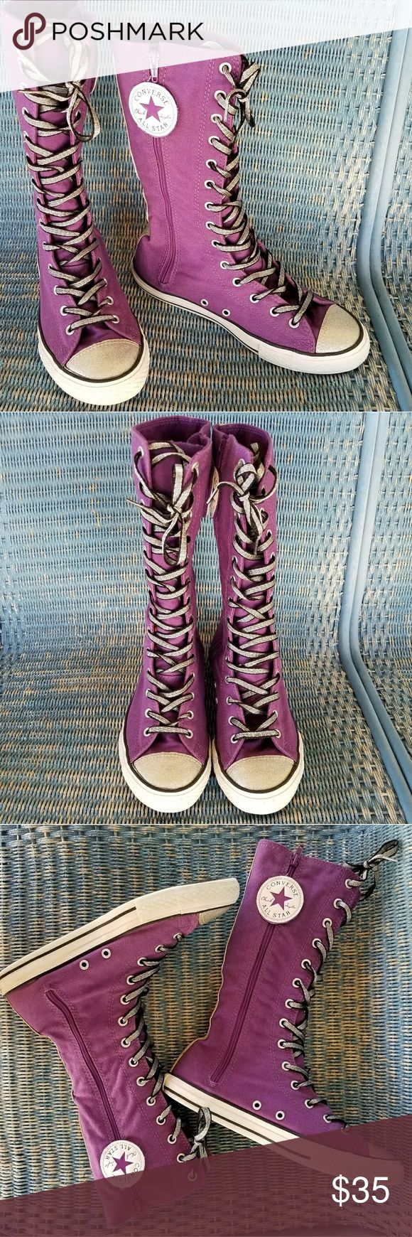 """Purple Zip Chuck Taylor Glitter High Top Converse ***Last photo shows true color***  This is a pair of Chuck Taylors by Converse.  They are in excellent condition!  Shoes are a youth size 5.5...I believe that converts to women's size 7.5/8 Length of shoe is 10.5 inches long.  Dark purple in color with white soles and silver glitter toes with silver glitter trim up the back of the shoe.  The laces are black and metallic silver. Shoes lace up or zip up the side and velcro.  Shoes measure 11""""…"""