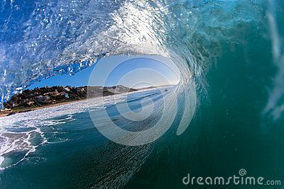 Large morning wave with size starts pitching or crashing towards the shallow water base . Photo image captured from a water housing with camera and wide angle lens inside the hollow wave crashing towards the beach coastline in Balito Bay South Africa