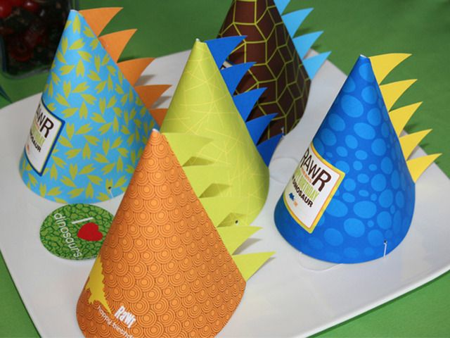 for Alex's 2nd bday! construction paper and dino scrapbook paper, using another pin to make the cone shape.