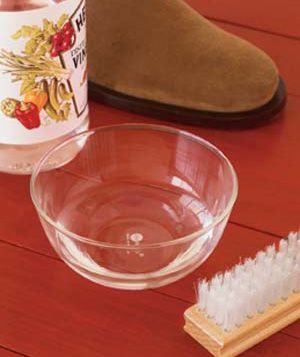 Cleaning salt-stained leather and suede shoes. Make a solution of equal parts white vinegar and water. Dab it onto a cotton rag (or a nylon-bristle brush if you're cleaning suede), rub gently over the entire shoe, then let dry.