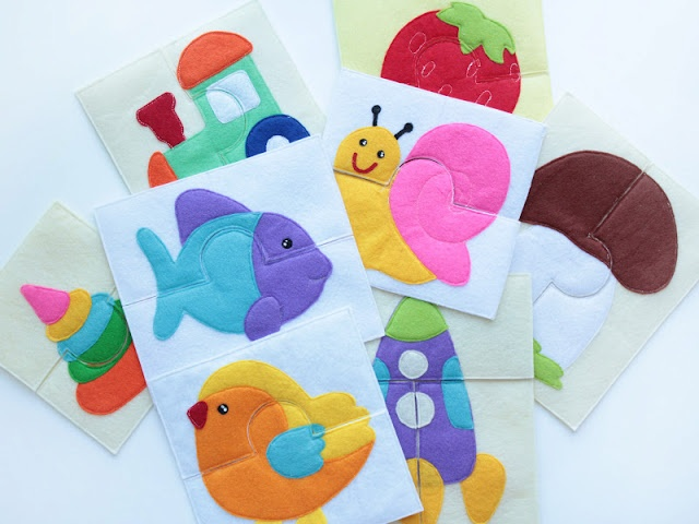 Adorable felt puzzles. Would be great quiet book pages!