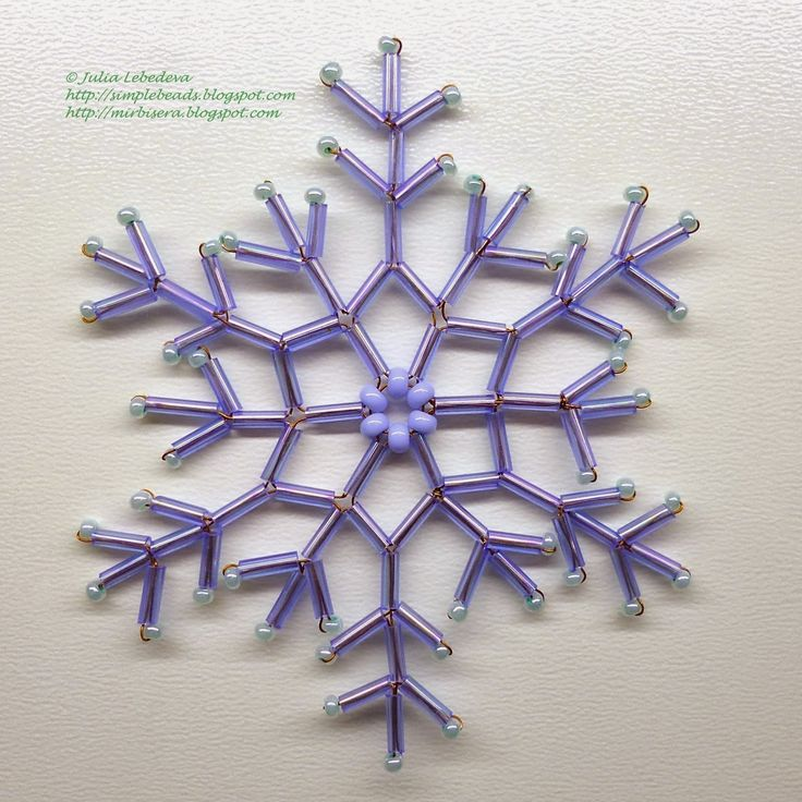 Beaded snowflake ornament. Page is not in English, but pictures are clear enough understanding of language is not needed.
