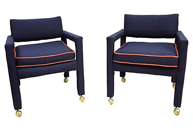 A stunning pair of Milo Baughman Parsons chairs on casters