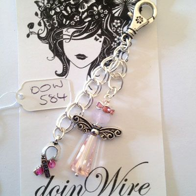 doinWire handcrafted  craft wire Clip-On dangler Angel with pink halo, pale pink spike crystal and Awareness Charm wrapped with bright pink crystals on chain. DOW584