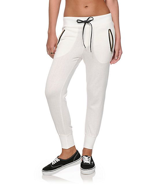 Clean up your look in casual style with these crisp solid white joggers that feature contrasting black adjustable drawstrings and zip pockets.