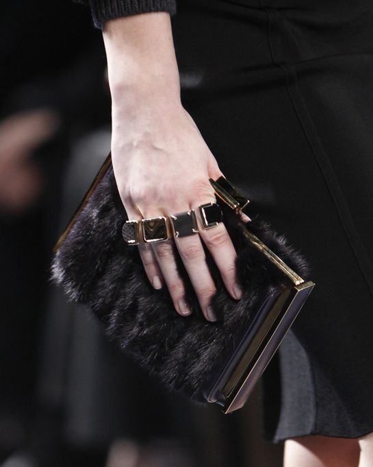 Multi-rings at Nina Ricci - Rings echoed the colors and fabrics used in the collection for Nina Ricci Fall/Winter 2014-2015, worn on every finger to take the look to its logical conclusion with accessories.