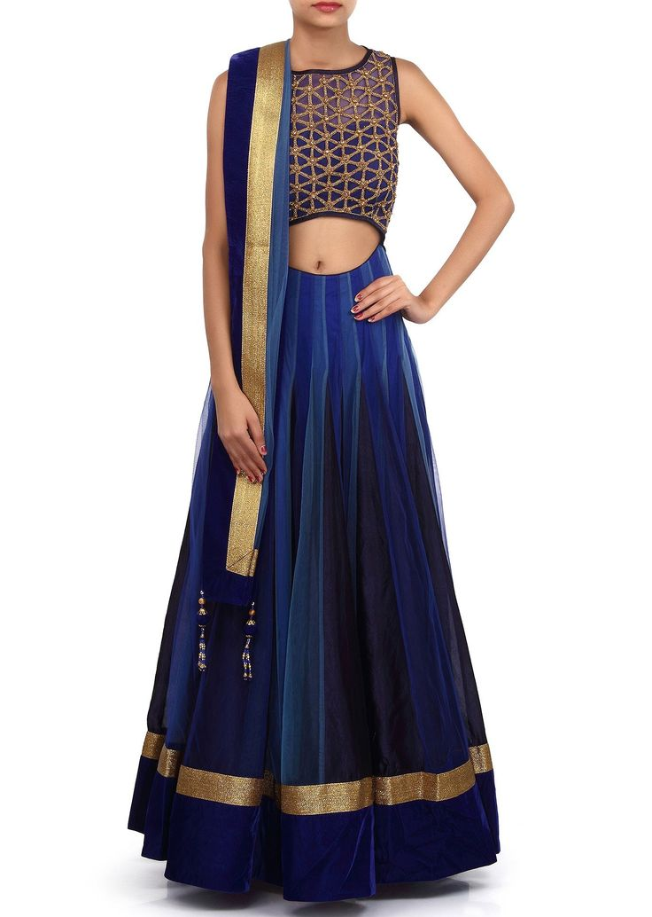 This lehenga choli is made in shaded blue net fabric. Blouse of this lehenga choli is weaved in kundan and zardosi weaving and improved in waist line cut work.