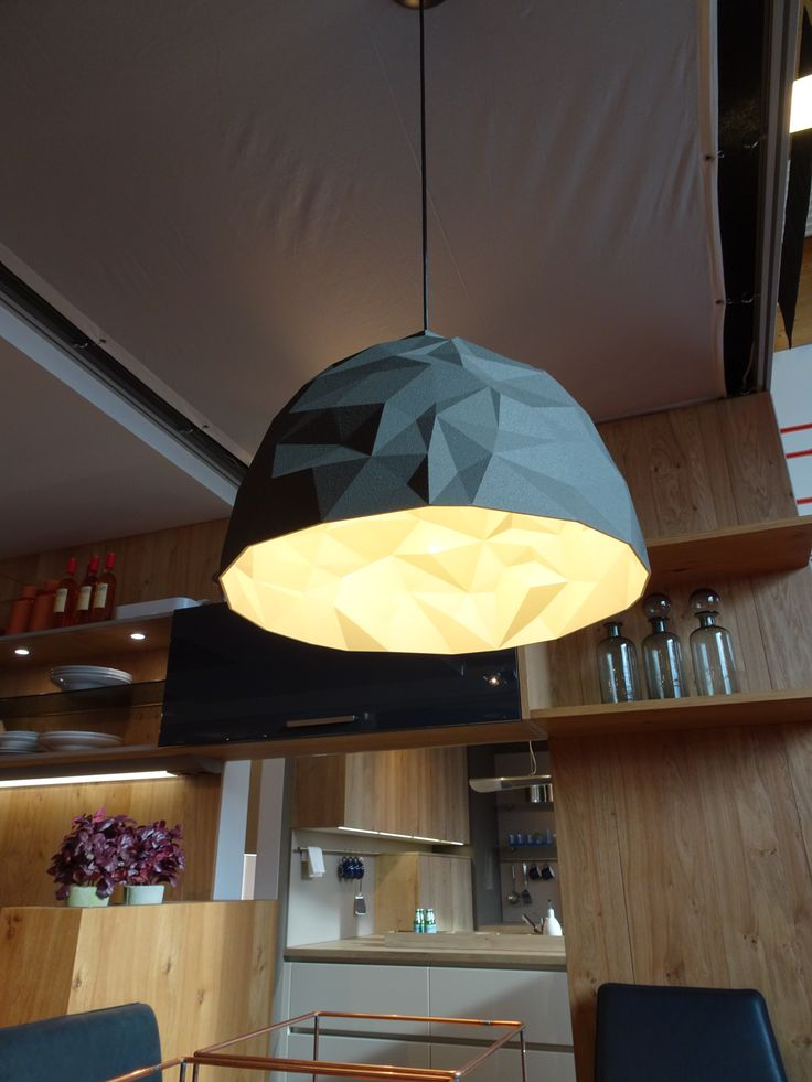 Stealth design inspired lighting fixtures with a metallic glaze on the inside for warm light reflexions