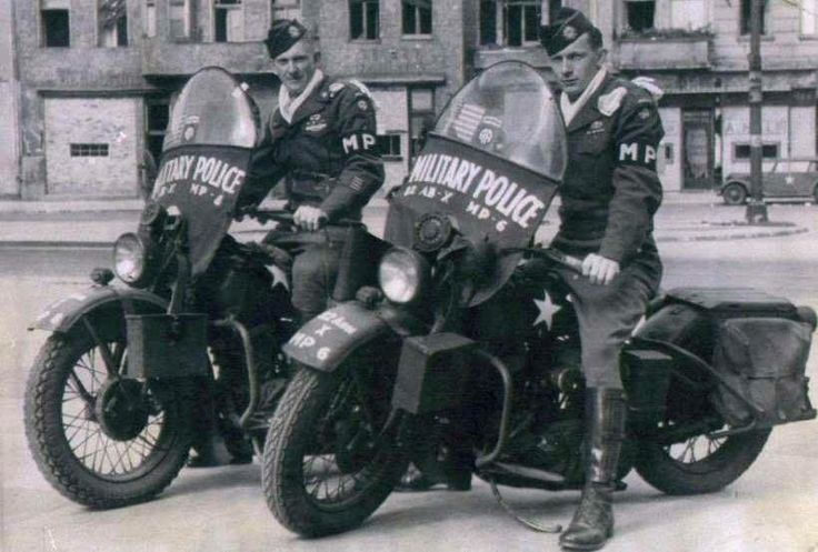 Two corporals of the 82nd Airborne Division's MP Platoon patrol Berlin on a pair of Harley-Davidson WLAs - May 1945