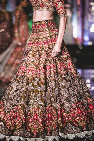 Bridal Lehengas - Brown Bridal Lehenga with Red, SIlver, Beige, Pink Threadwork | WedMeGood | Outfit by: Manish Malhotra #wedmegood #indianbride #bridal #threadwork #lehenga