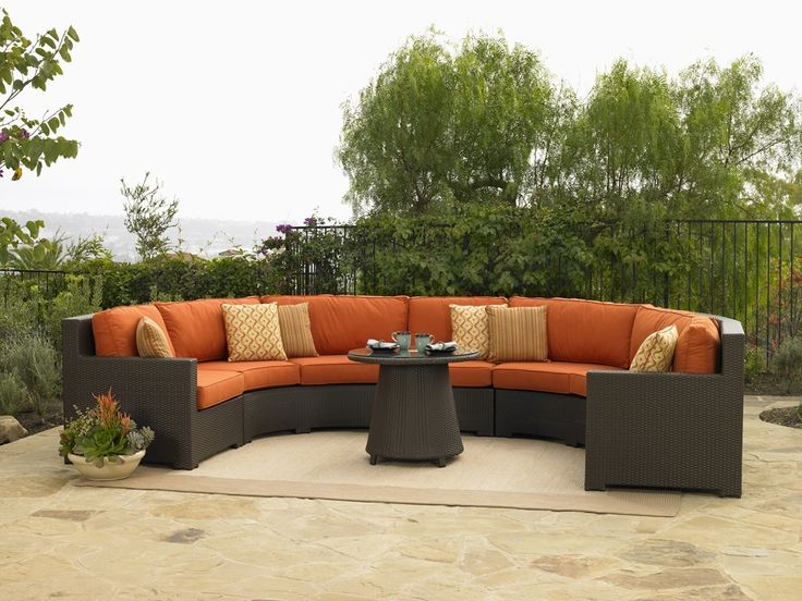 Furniture: Black Paint Metal Material Hedges Green Outdoor Plantation Surround Bright Weather Natural Lighting Outdoor Living Room With Dark Brown Large Sofa Orange Cushion Motif Cushions: Superb Outdoor Furniture in Beautiful Place