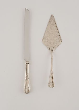"""Add a vintage flare to your cake table with this beautiful serving set in sparkling silver. Its antique charm will ensure your cake cutting is picture perfect on your wedding day as well as on anniversaries, birthdays, and other special occasions thereafter. Features and Facts:  Measurements: Knife is 1"""" W x 14 1/4"""" L x 1/8"""" H. Server is 3 1/7"""" W x 11 1/4"""" L x 1/2"""" H.  Material: Zinc Stainless Nickel Plating.  Set includes knife and server."""
