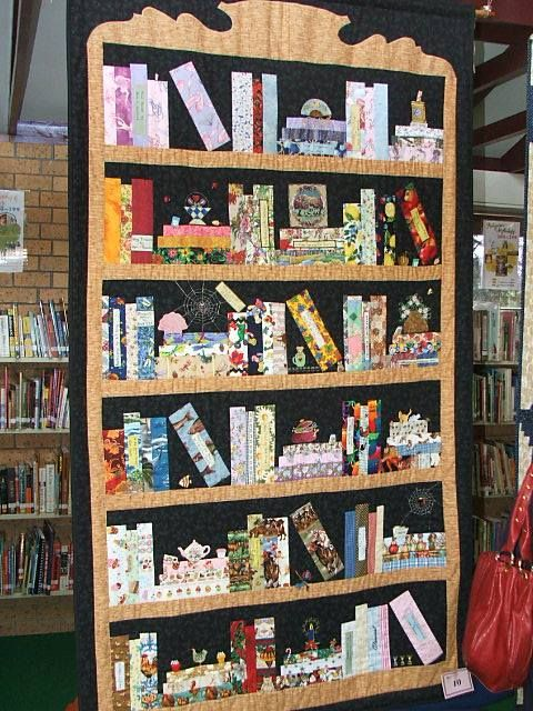 "Edith Newman, 'My Book Case Quilt' ""This was my entry in the local Quilt Day in 2008. There are no two blocks the same and each block has a theme. Top left is ballet fabric,top centre japanese, top right fairies etc. and there a couple of redback spiders in there as well."""