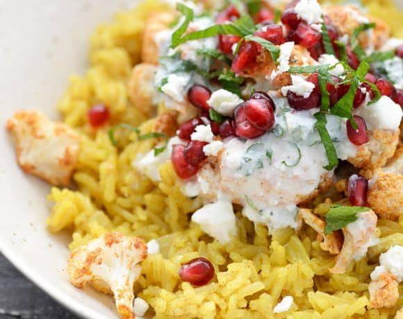 Tandoori Cauliflower Bowls! These bowls are so delicious and healthy! Turmeric Basmati Rice with Tandoori Cauliflower, a feta-yogurt sauce, mint and pomegrante. #glutenfree #tandoori #healthy #vegetarian #cauliflower #healthy #recipes #pomegranate #rice | www.delishknowledge.com