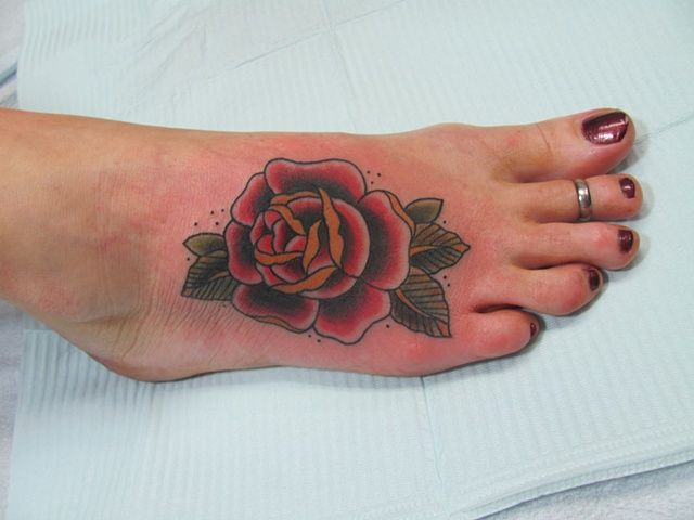 Rose foot tattoo, but in yellow