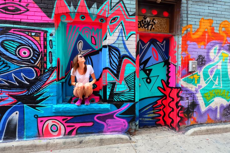 Exploring Graffiti Alley in Toronto | Twirl The Globe   This seems like a really cool area to visit and walk. Ready to go to Toronto?  Email me at Deb@VacationsByDeb.com or call me at 877-331-5078.