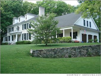 beautiful farmhouse style home with stone retaining wall in Milton, Massachusetts
