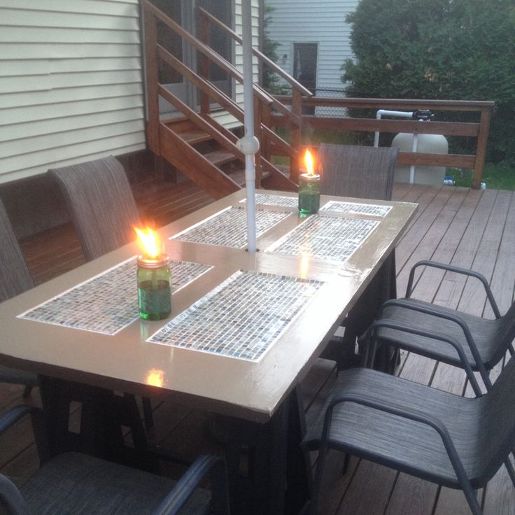 Patio table made from a wooden door that we got from the Habitat for Humanity Restore and some clearances glass tiles...