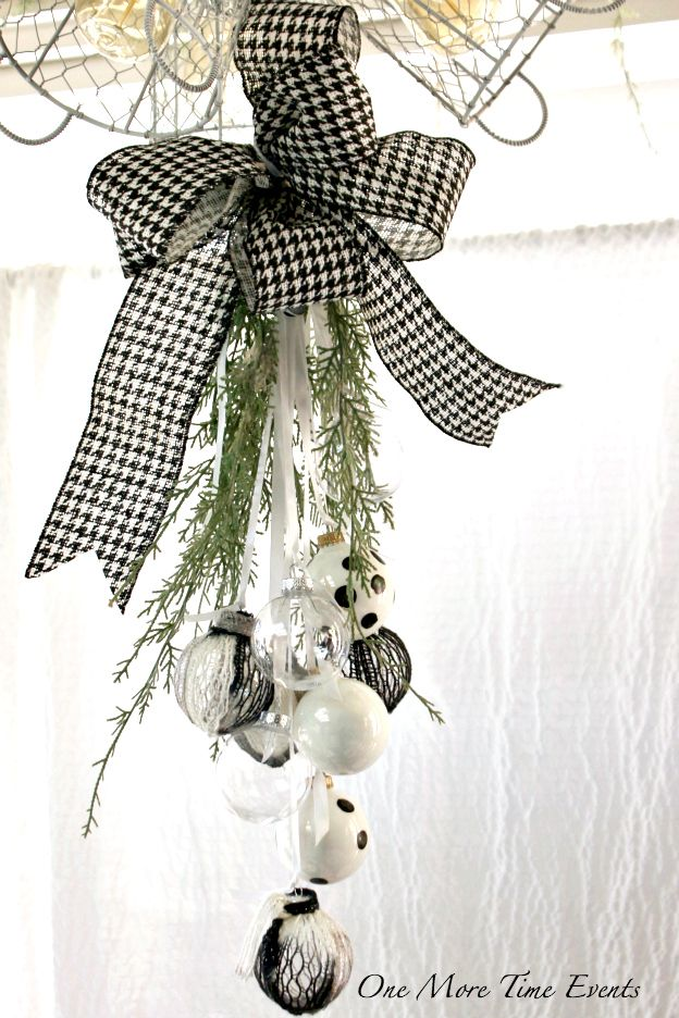 Christmas Ornament Swag Tear Drop swag using handcrafted Christmas ornaments.  I have to tell you when I decided to go with the colors of Black, White and Red in my Christmas decor, I didn't realize there was a lot toread more