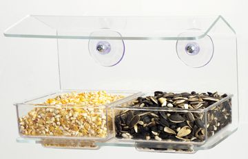 002 Buffet Double Seed Tray  Two types of seed can be used in this feeder, both trays are easy to remove and clean. 1/2 quart capacity.