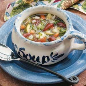 """Kidney Bean Vegetable Soup Recipe -""""My family loves this vegetable soup,"""" pens Lillian Palko from her Napa, California home. Chock-full of kidney beans, celery, spinach, carrots, zucchini and tomatoes, the comforting broth is ideal to serve on cool autumn days with a loaf of crusty bread or warm biscuits."""